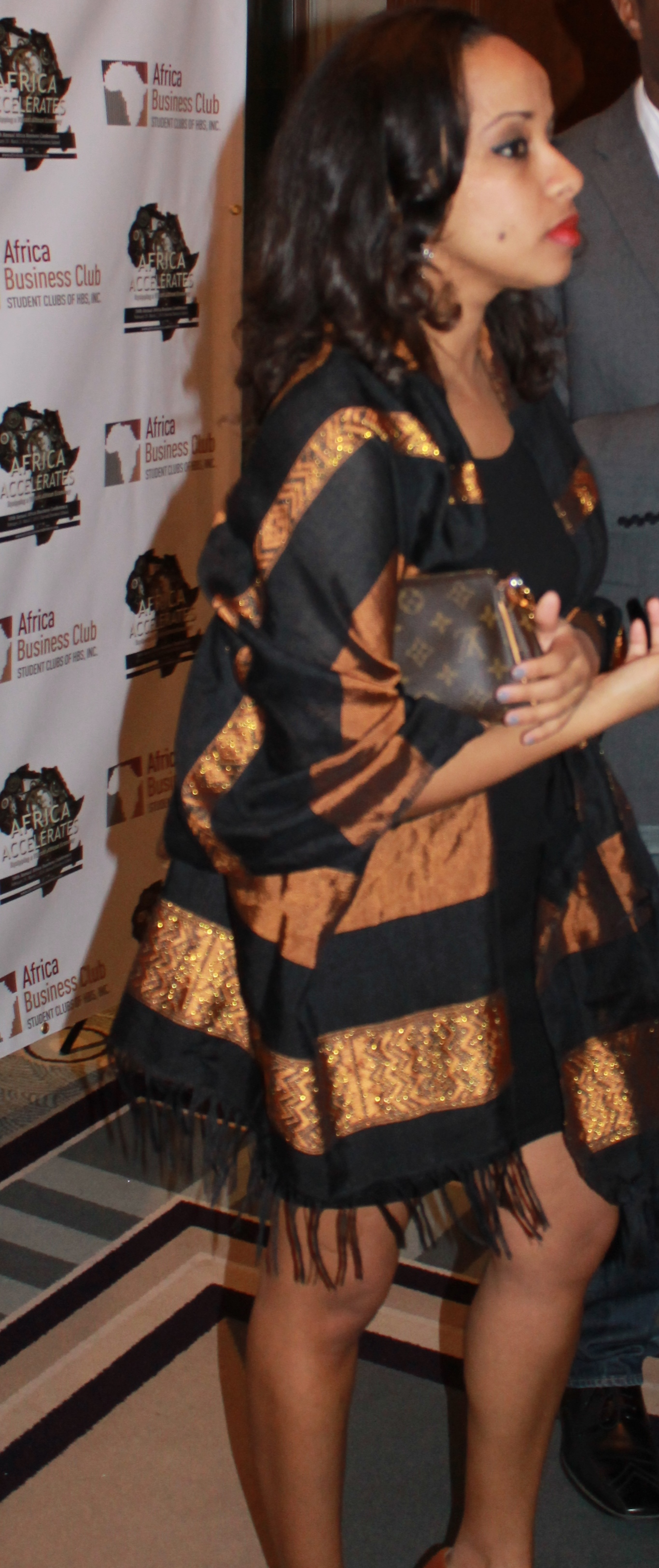 I'm not quite sure if this scarf was African-made, but its definitely inspired by traditional Ethiopian scarves. I love the way this young lady used it to turn up her LBD.