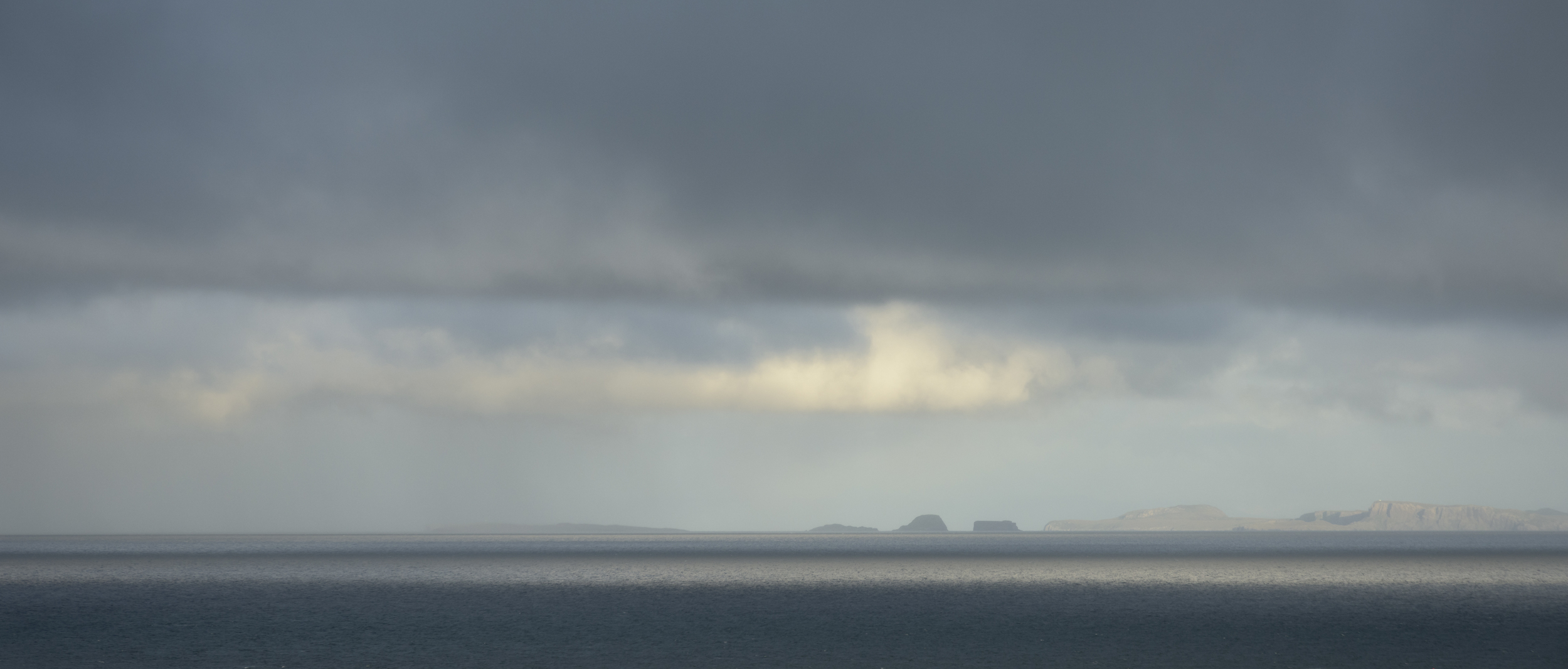 Cloud comes in from the west leaving only across the Little Minch and northern Skye in evening sunlight.