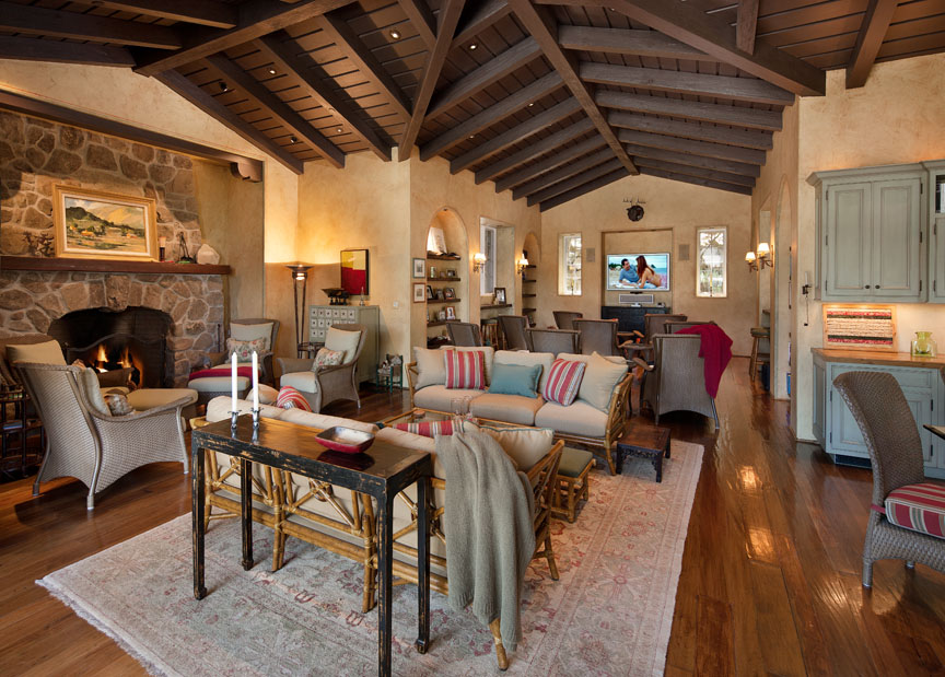 This mountain retreat pool house has a cozy stone fireplace, media area and nearby game room