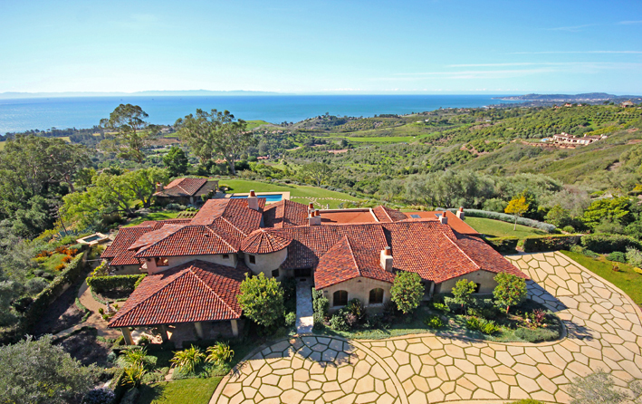 The motor court and ocean view of a Montecito estate.