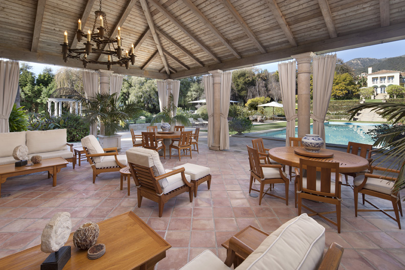 The pool pavilion at this Riskin Associates listing offers ample indoor and outdoor dining amenities.