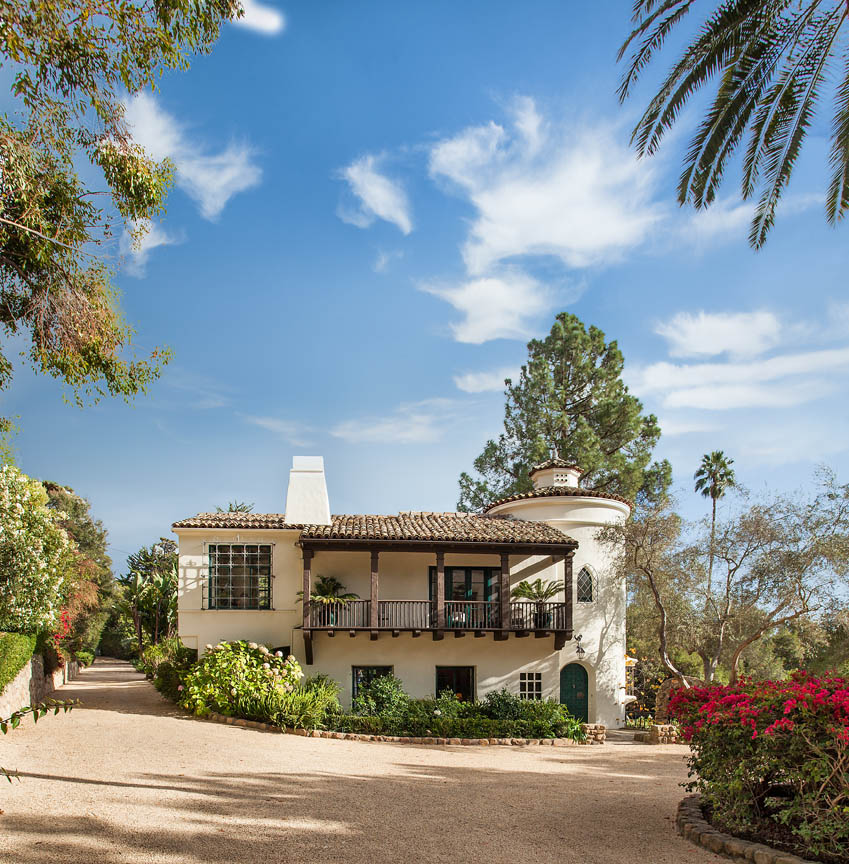 This Spanish Revival Compound overlooks lush grounds and brilliant ocean views.
