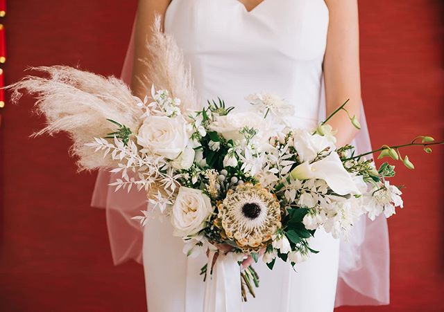 Another current fave - Pampas, bleached ruscus, white protea, calla lily, roses, scabiosa, orchids, and many more! 😍😍😍 - ft. an all white bridal bouquet