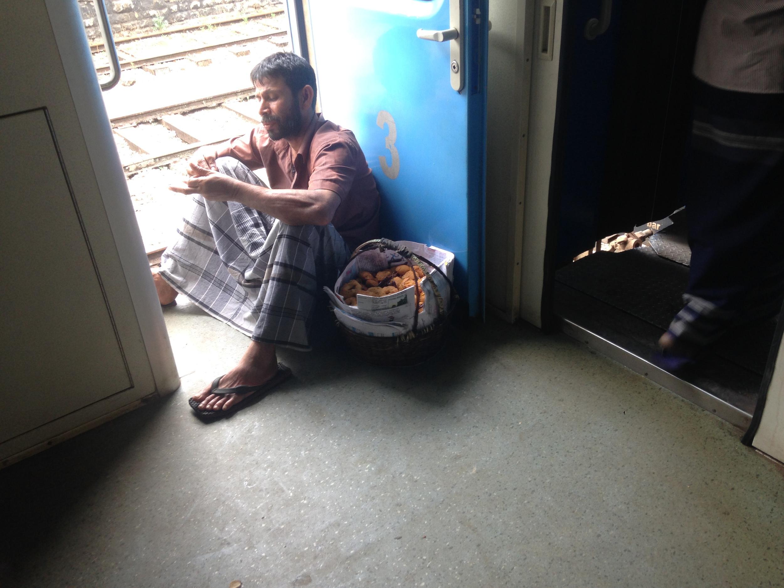 A vendor taking a break on the train.