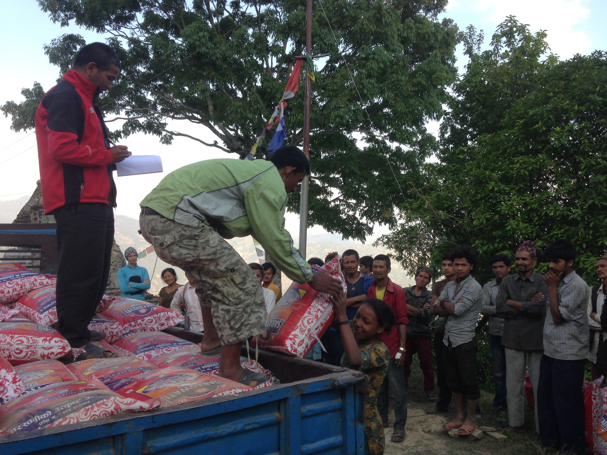 Receiving food for the first time since the quake.