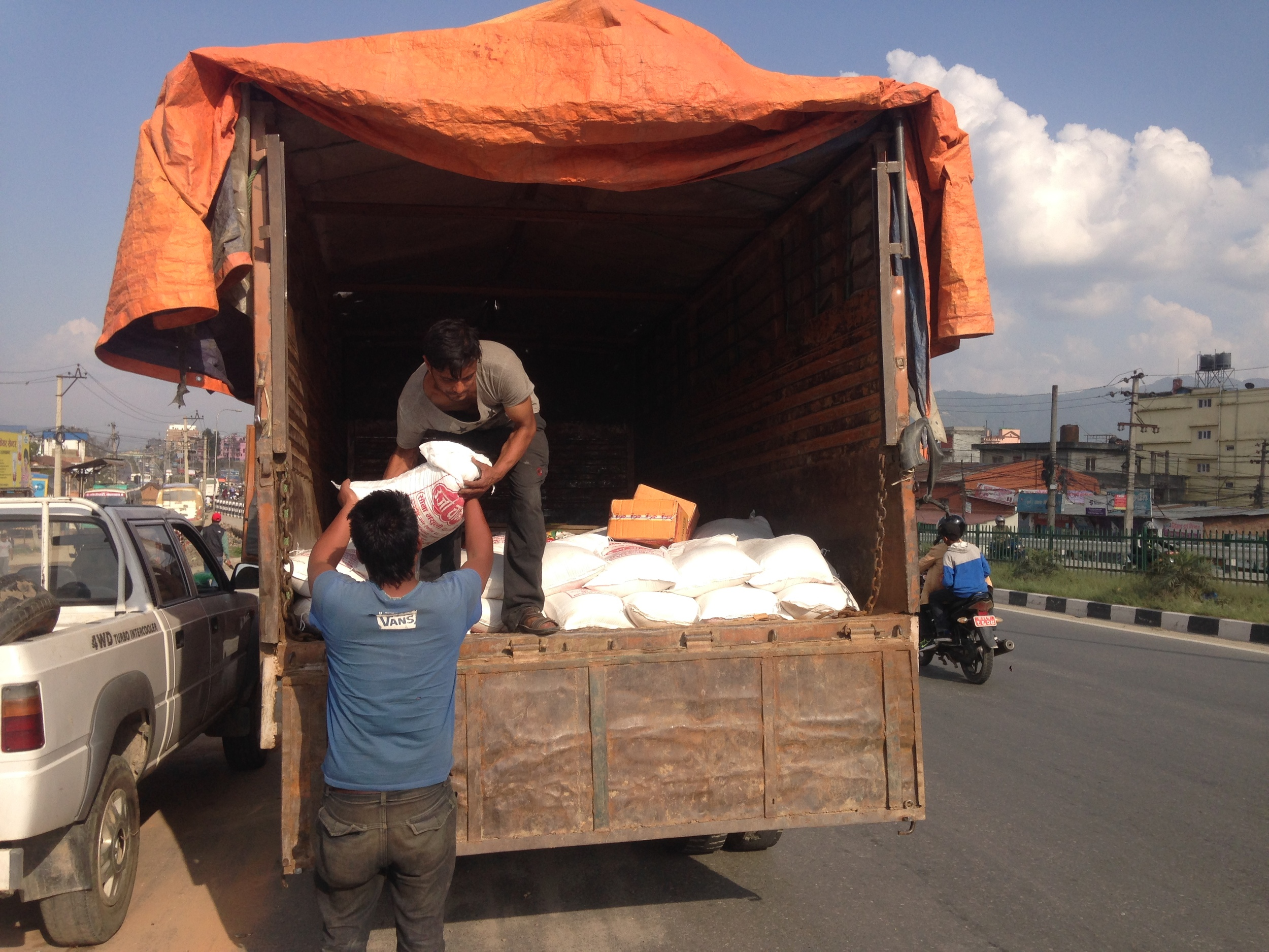 Loading a truck with rice.