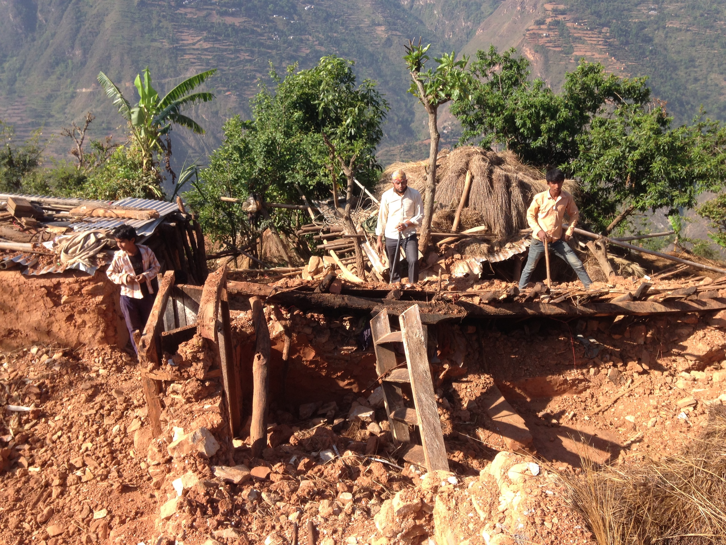 Nepalese digging out their home.