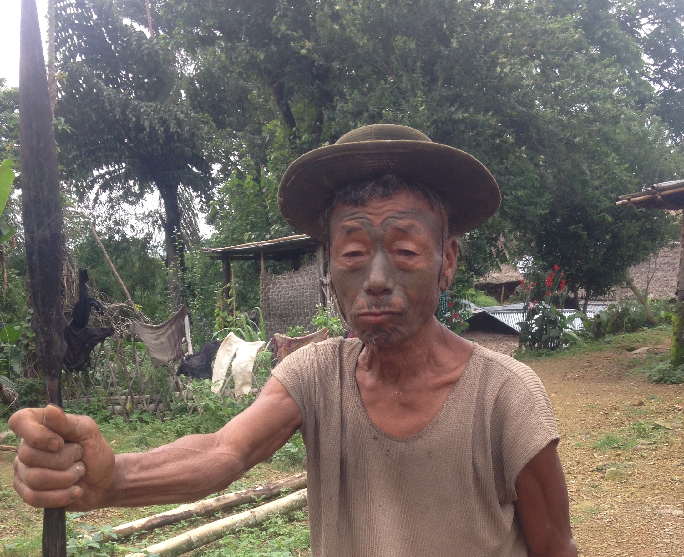 Chiangkem of Longwa Village, one of the few remaining face tattooed Naga warriors.