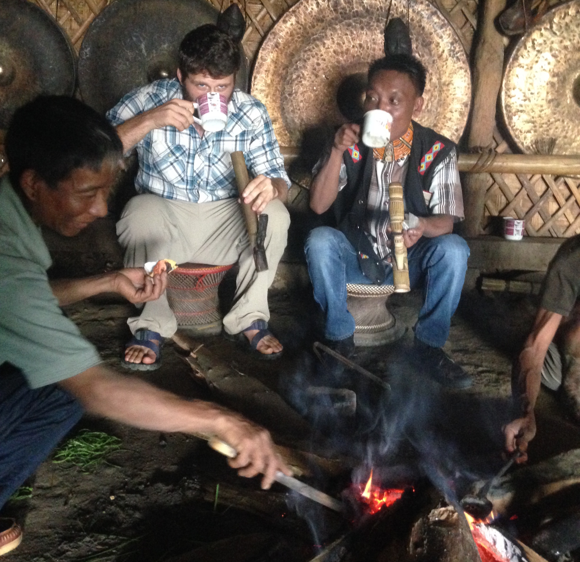 Drinking tea with Chief Ang of Longwa Village.
