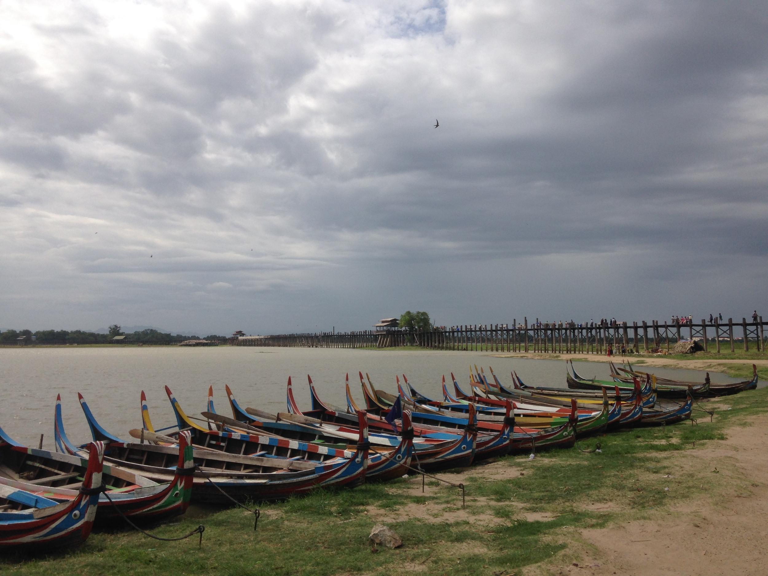 Boats in front of the U Bein Bridge near Mandalay