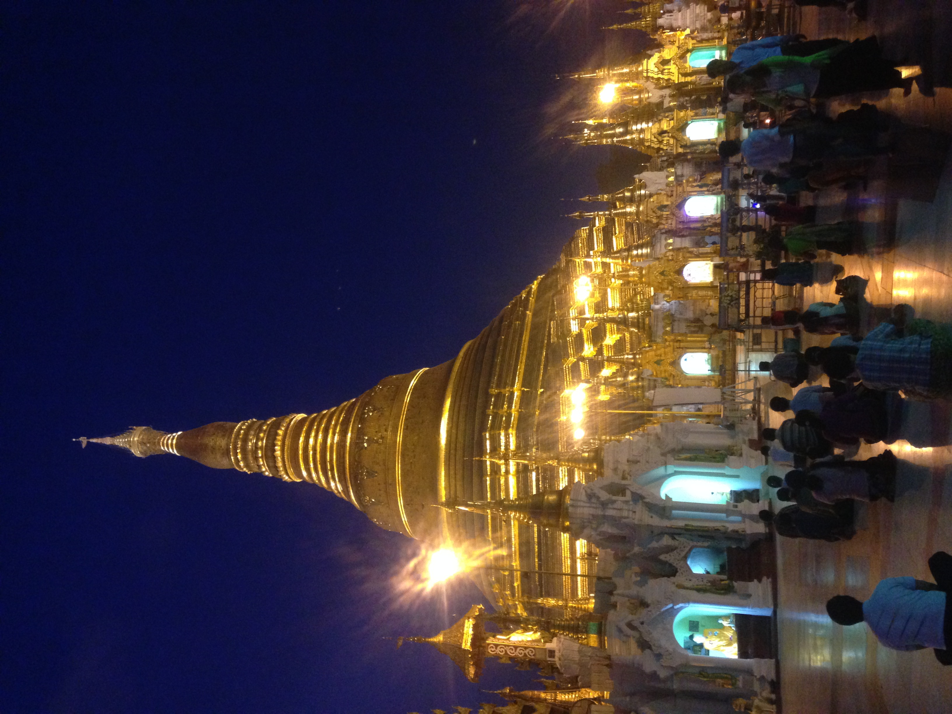 Praying at the Shwedagon Pagoda in Yangon before sunrise