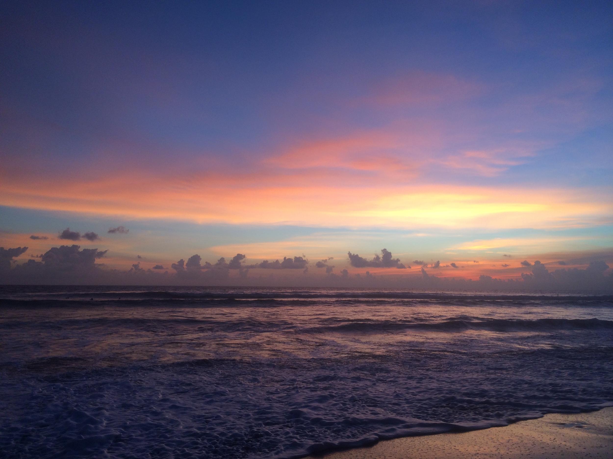 A typical beautiful sunset on the coast of Canggu, Bali
