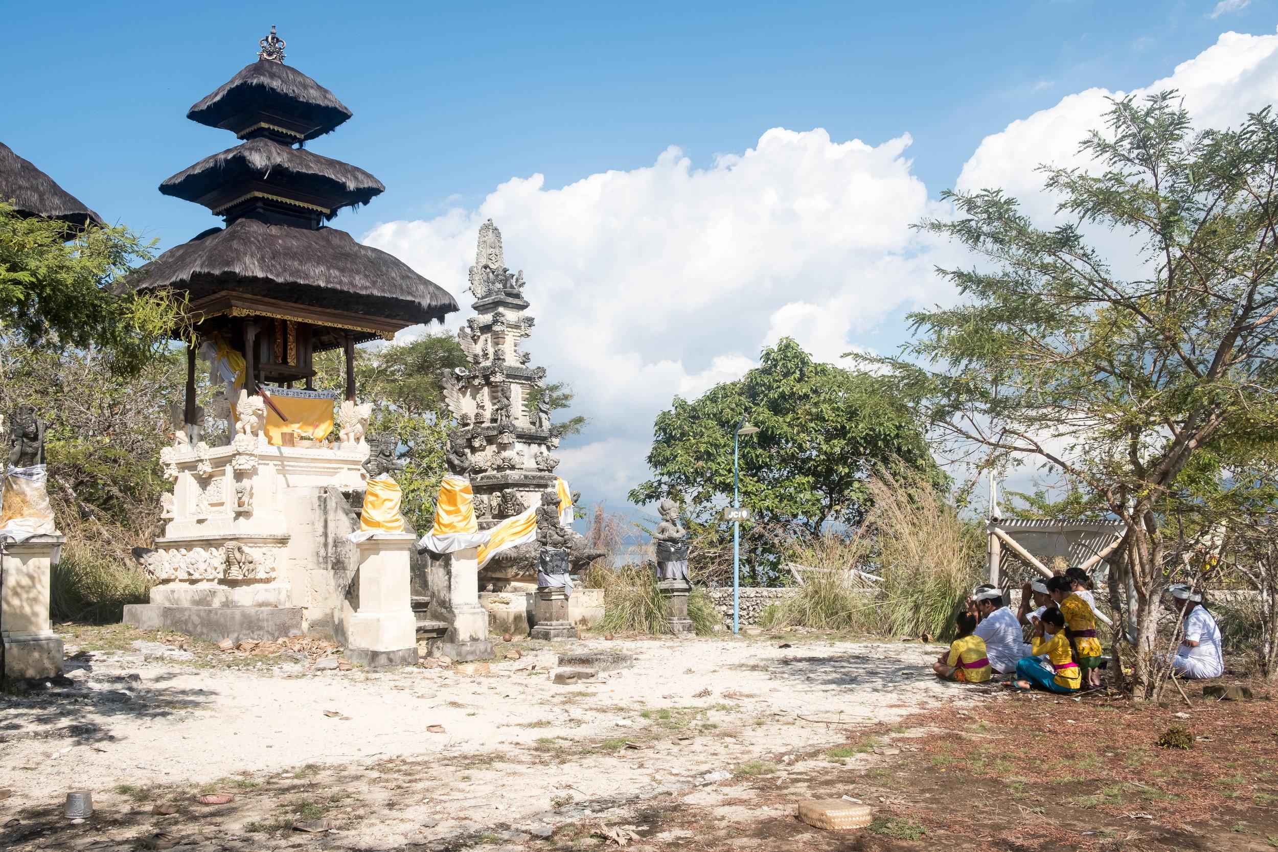Balinese family praying