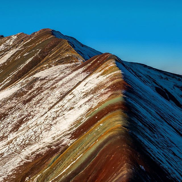 Rainbow Mountain up close after a snow flurry and from a distance in the afternoon. #peru #cusco #5000meters #rainbowmountain #photography #landscapephotography #landscape #travel #travelledworld #travelphotography #backpacking #hiking #ausungate #optoutside #outdoors #outdooradventures