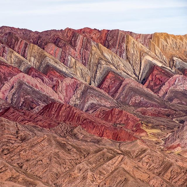 """Easily one of the most interesting mountain landscapes I have ever seen. Rainbow mountain in Peru has nothing on this """"14"""" colored mountain in northern #Argentina. Can you count the 14 colors? #humahuaca #jujuy #travel #travelledworld #naturephotography #travelphotography #nature #landscape #landscapephotography #optoutside #adventure #fuji #photography #mountains #colors"""