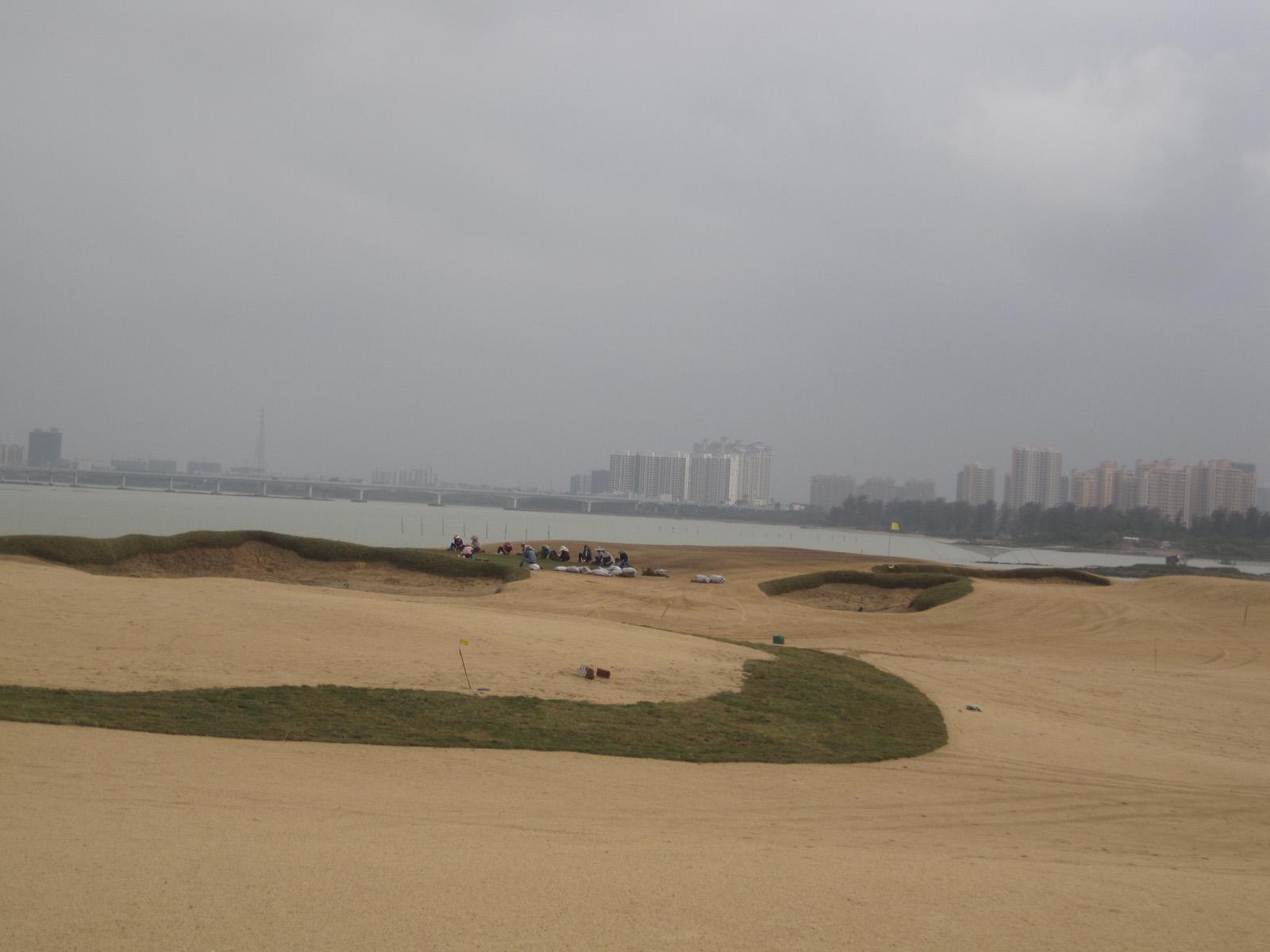 Final grassing at Tom Doak's Simapo Island in Hainan, China.
