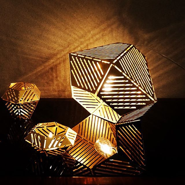 inspired by Prague art déco interiors and Czech cubist designers, brass candle holders and lamps punched using a numerical control machine  http://www.filippolosilab.com #design #filippolosilab #brass #lamps #lightdesign #geometric