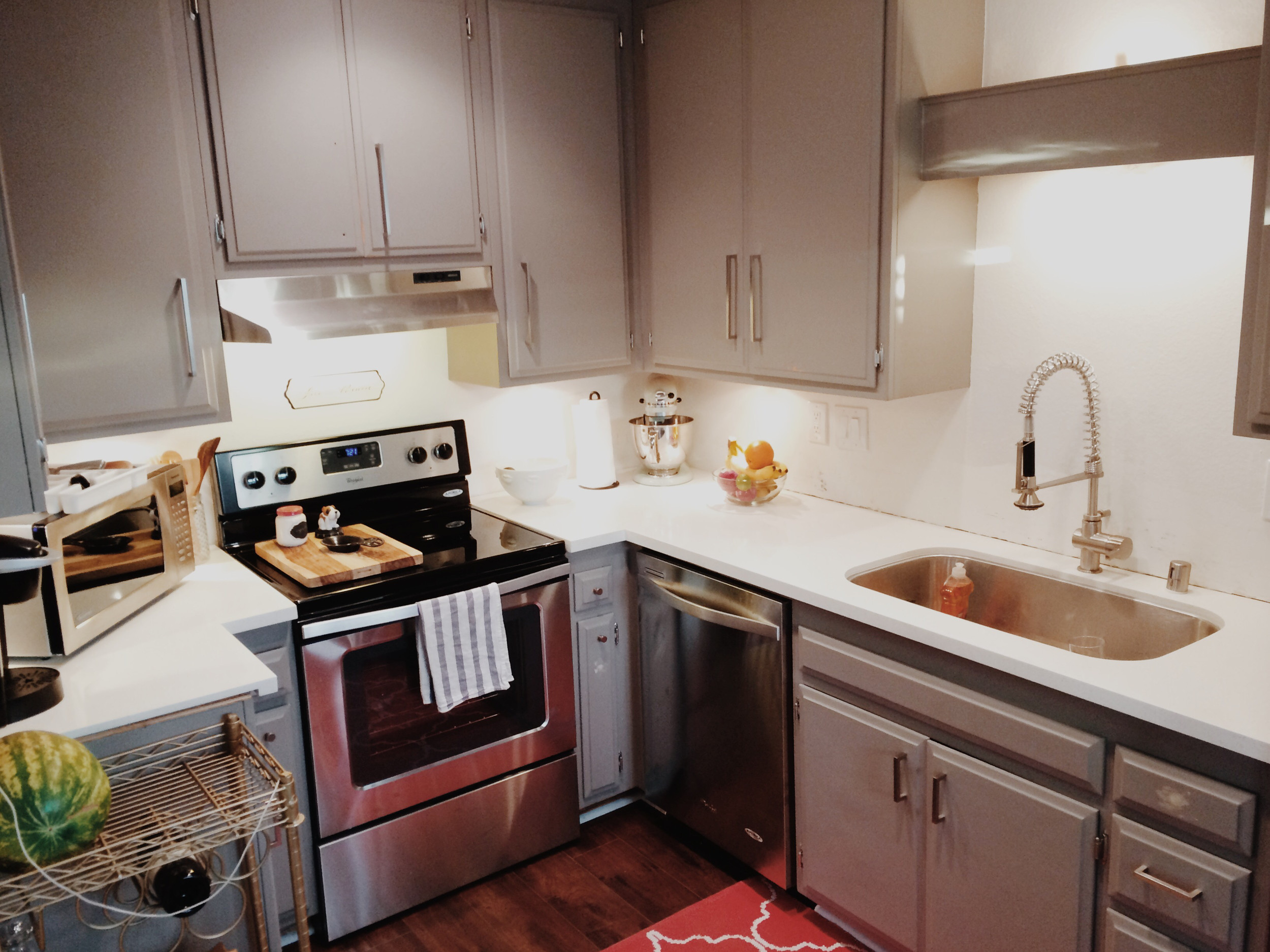 kitchen after see sources for:  flooring ,  cabinet paint