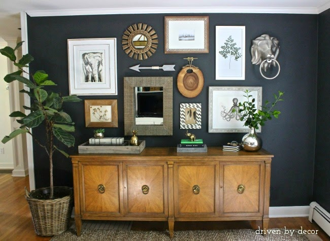 This is a great example of mixing objects and framed prints. Keeping the color palette in check and maintaining an appropriate spacing between items keeps this gallery from becoming a disjointed mess.