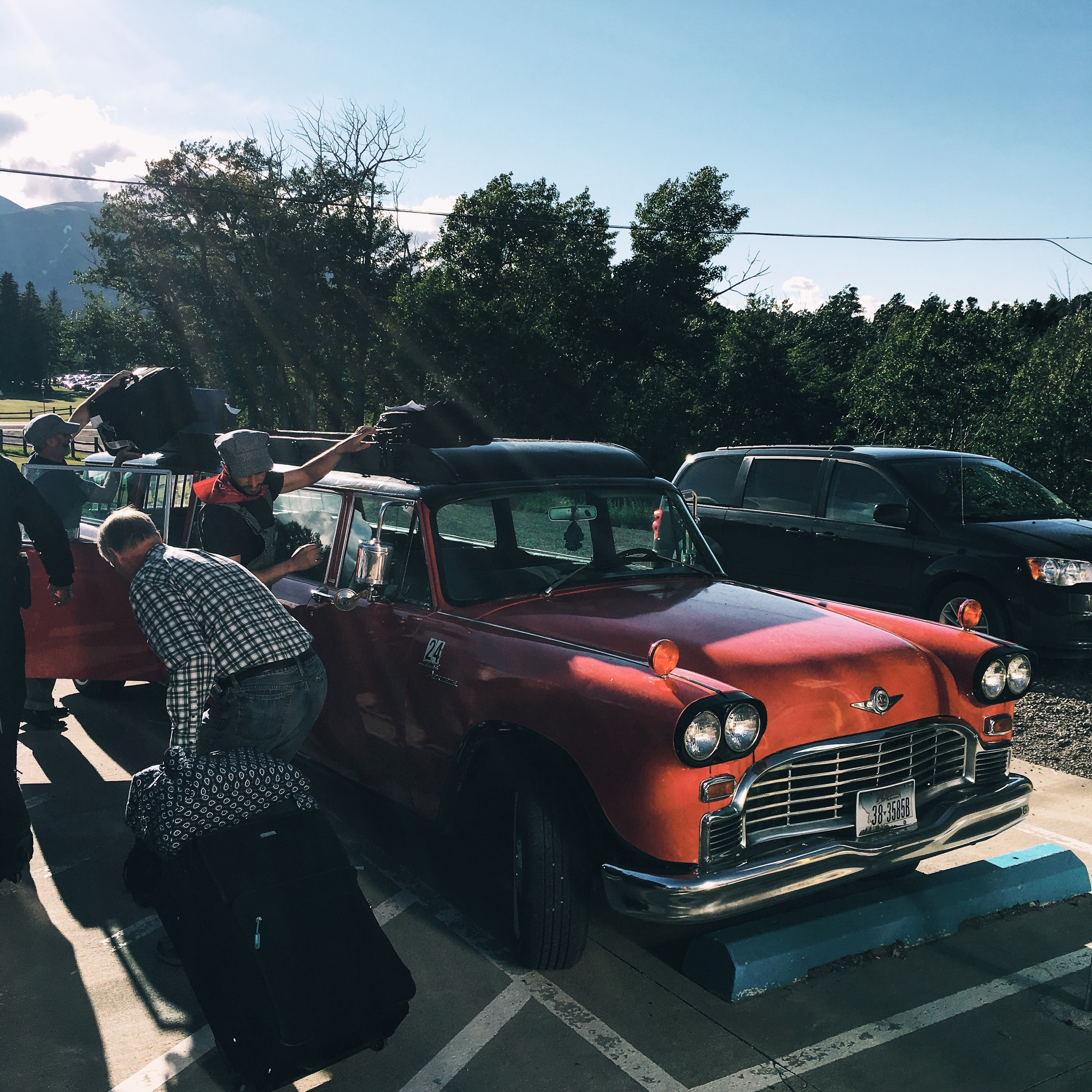"""The famous Glacier National Park """"reds"""" driven by Jammers. Don't make the mistake of saying you rode a Jammer all day."""