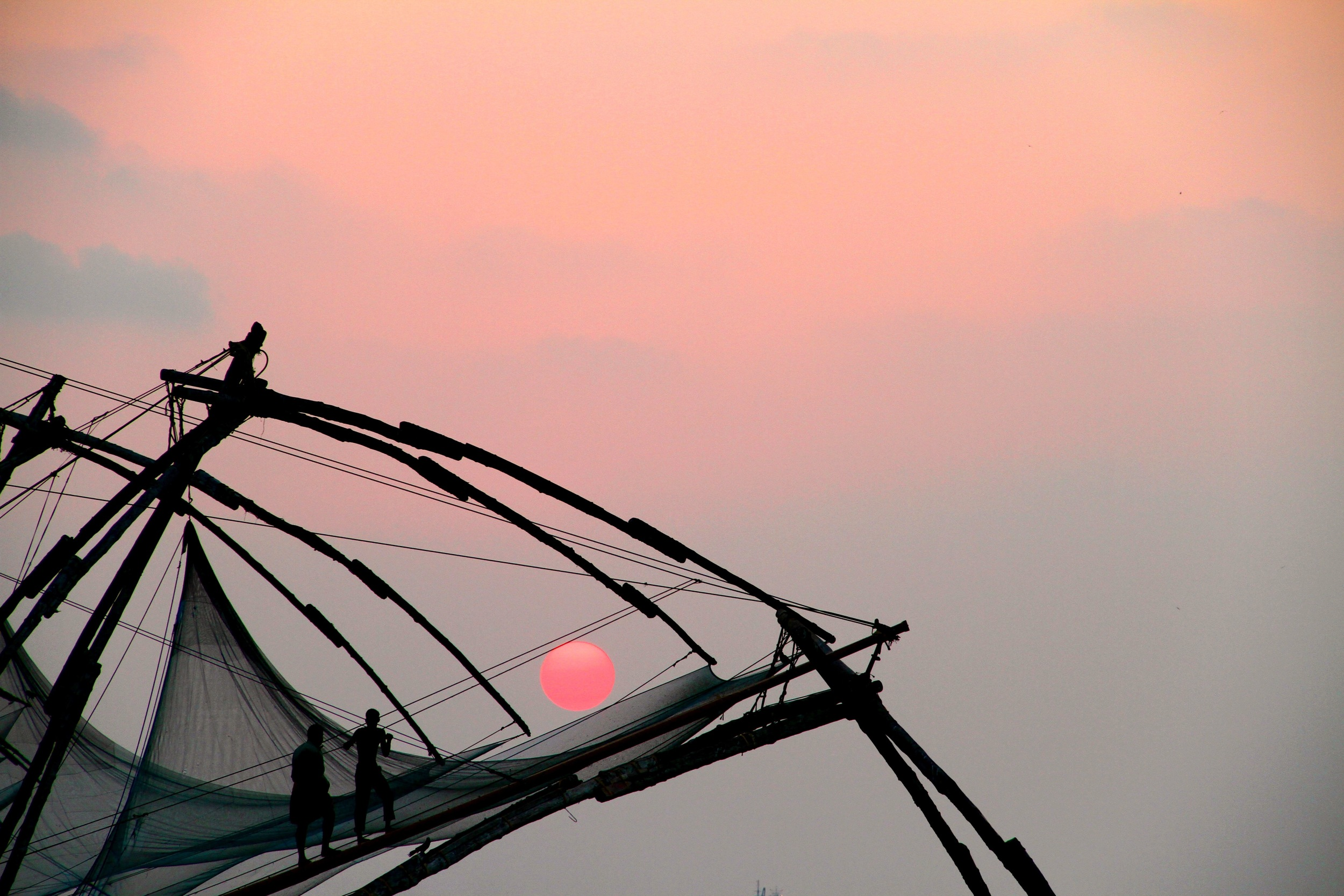 Sunset over fishing nets   —   Kochi, India