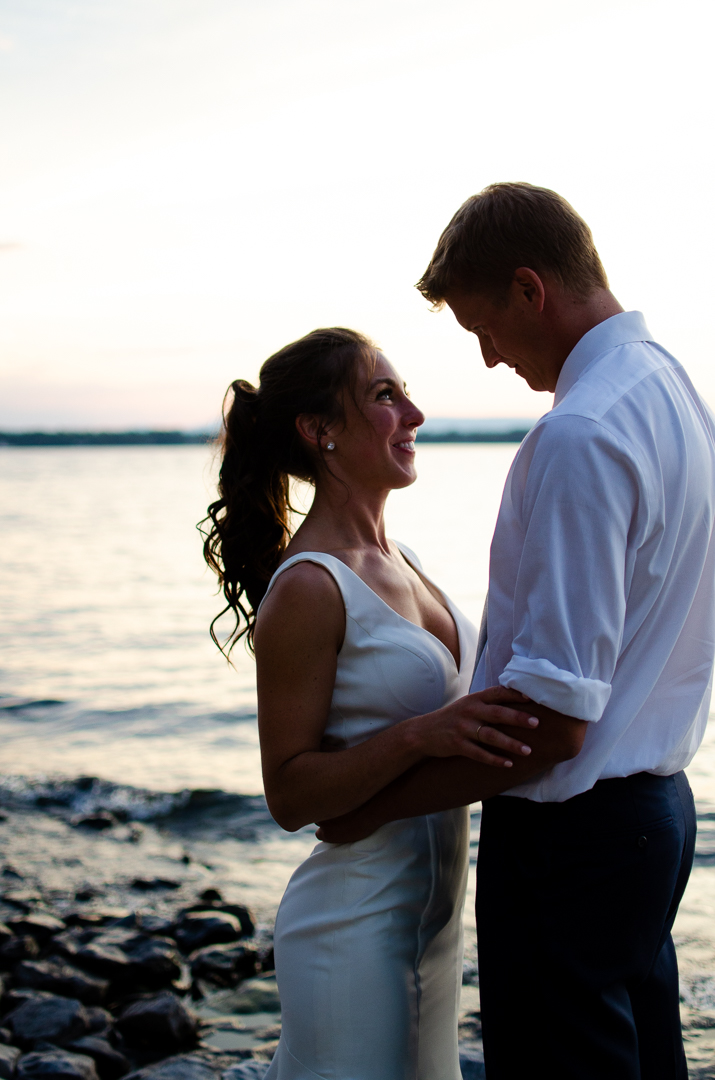 couples portrait by the lake after the wedding