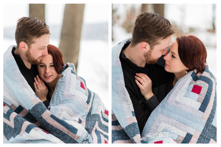 vermont winter engagement wrapped up in a quilt