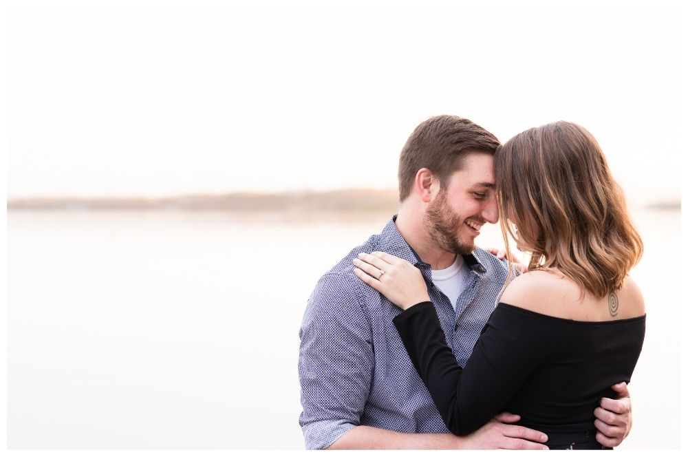 couple engagement session lake champlain at sunset