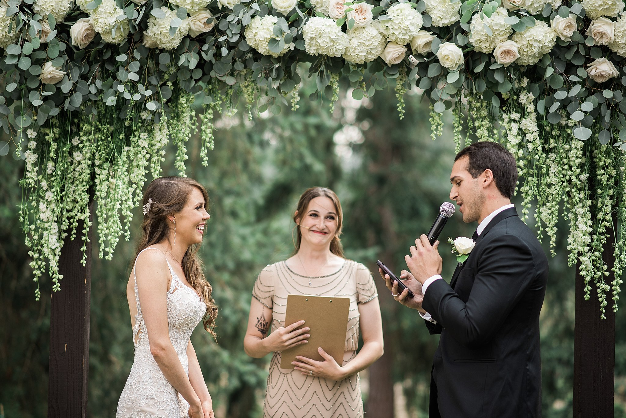 Candid of the bride during their vows. Trinity Tree Farm Wedding