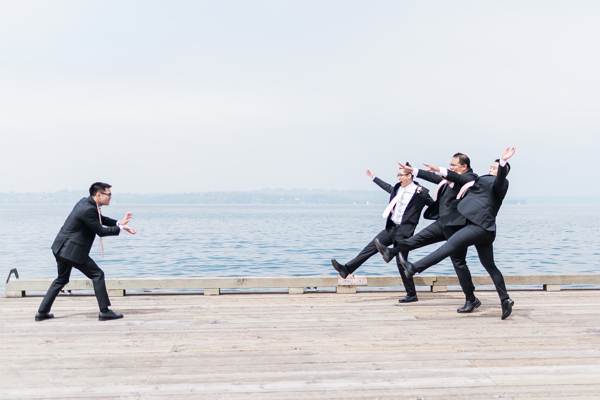 Creative bridal party posing photos. Woodmark Hotel Waterfront W