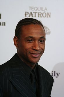 """Tommy Davidson - Tommy Davidson was adopted into a white family in 1966 at the age of two. Growing up in the time of the Jim Crow Laws with a white family wasn't easy for him. He faced racial prejudice, but was too young to understand the reasoning behind it. Tommy had a different view on race. For example, he thought of skin tones as they are described on crayons; he was a brown color while his sister a peach color. Tommy said, """"The love that I got didn't have any color,"""" (Gebreyes, 2014).Huffington Post Interview video[image from Wiki]"""