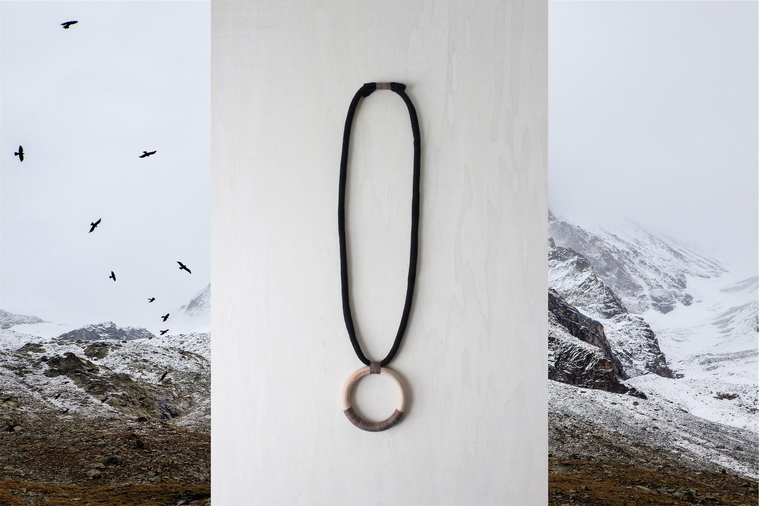 FORESTIERE eclipse necklace mountain scene.jpg