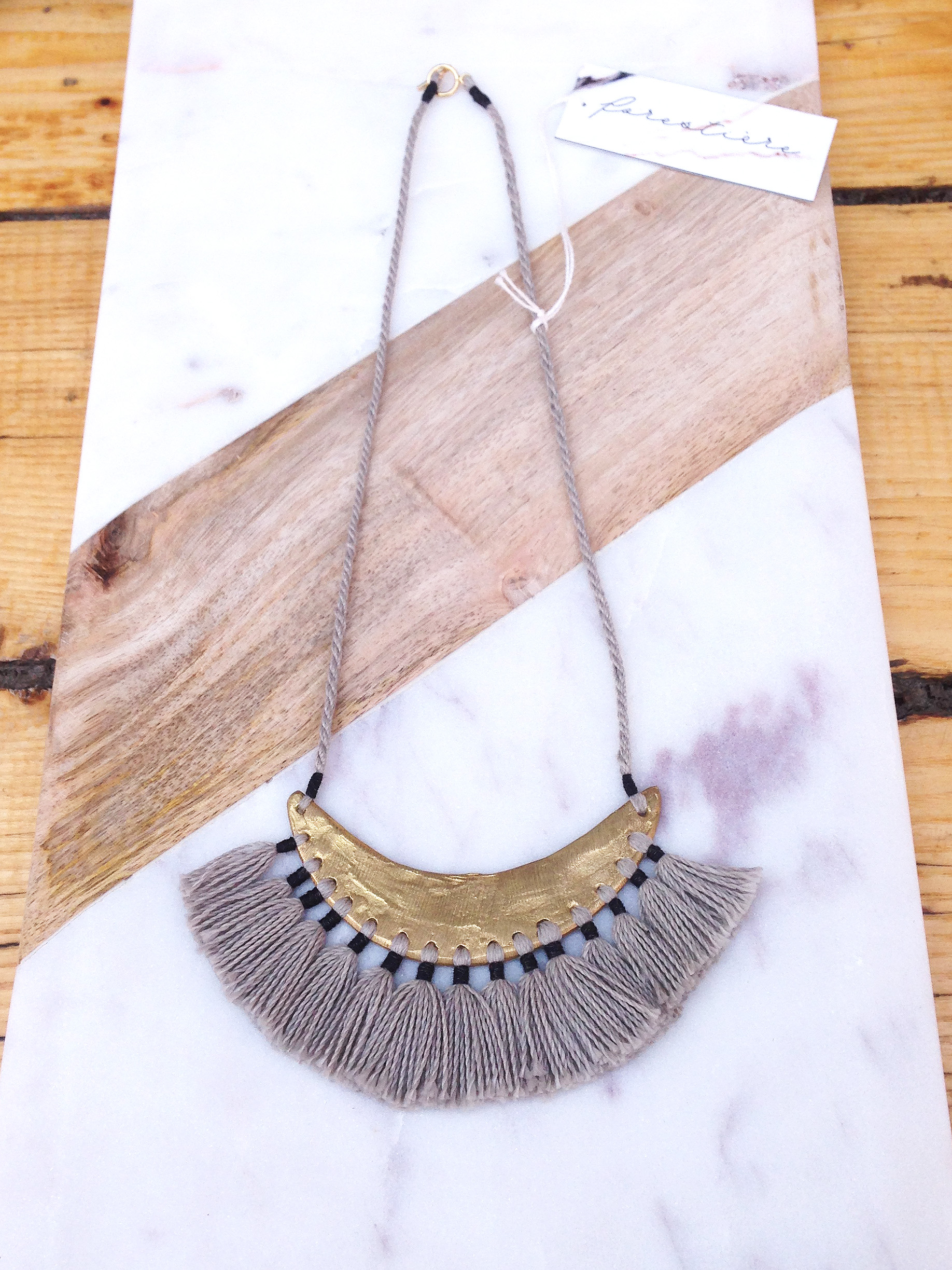 FORESTIERE fringe collar display at INLAND Spring 2015 copy.jpg