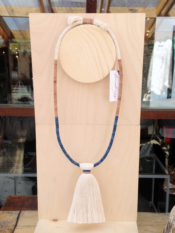 FORESTIERE indigo and bengara necklace display at INLAND Spring 2015.jpg