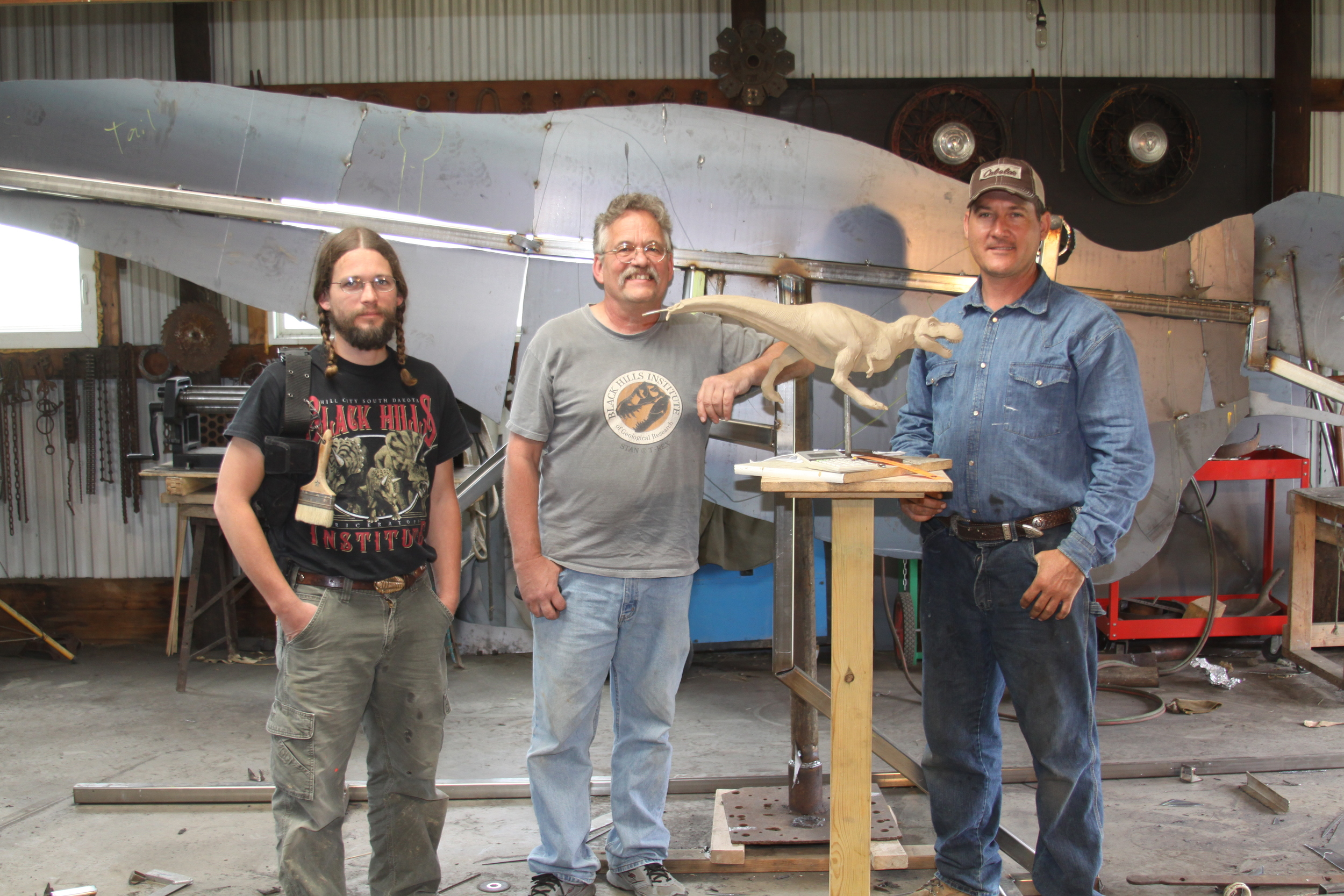 Pete Larson and his son stopped by the shop to help check out the T-rex in progress.