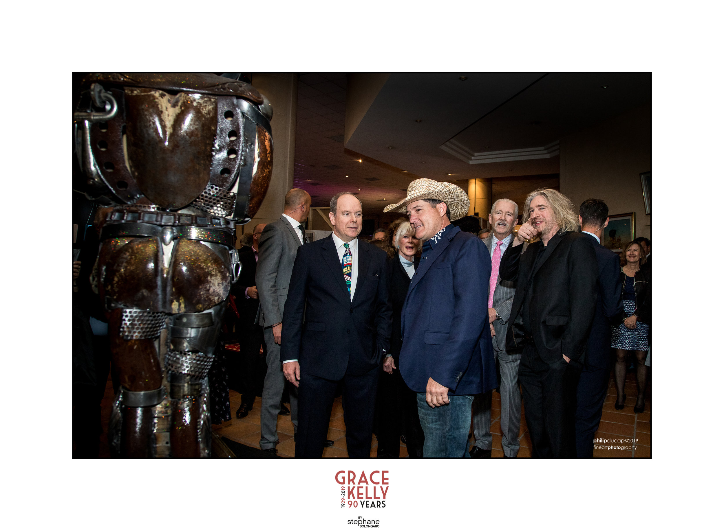 Prince Albert ll and John discuss the sculpture created for the event held in Monaco.