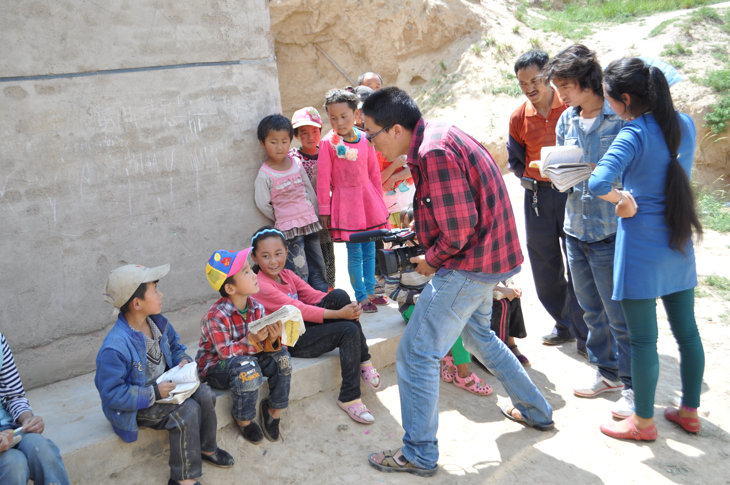 Khashem Gyal films children as they study Tibetan outside their classroom.