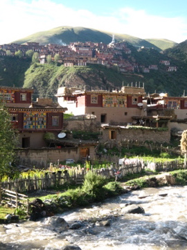 Tibetan homes with Dzongsar Monastery in the background