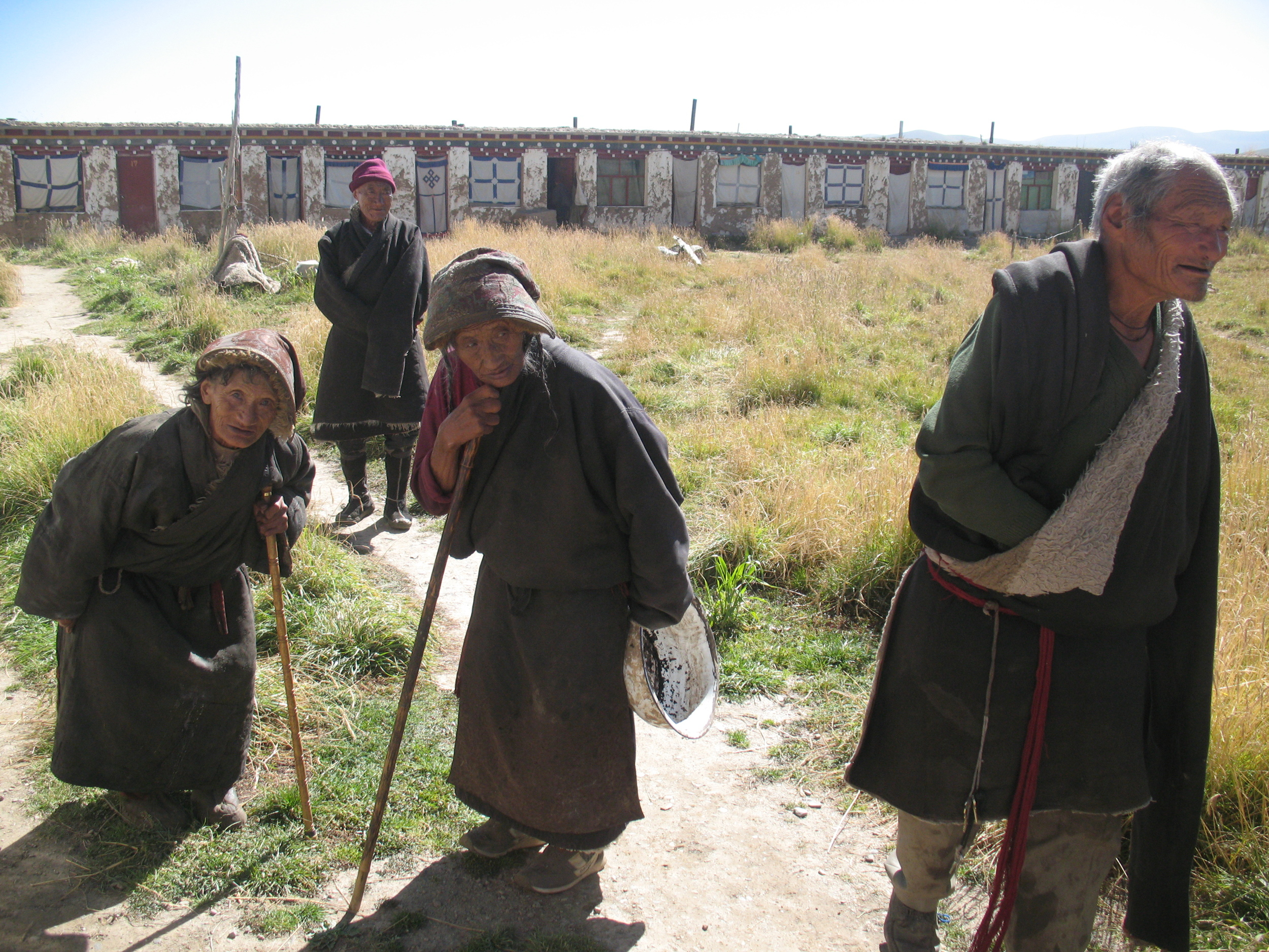 Elderly men and women preparing to do koras