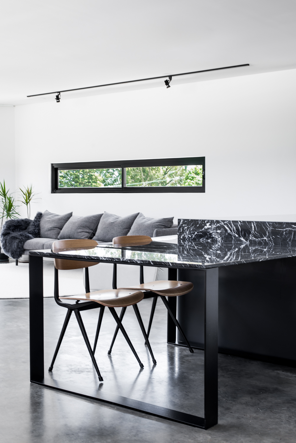 Triangle House by Robeson Architects - Custom Marble Table