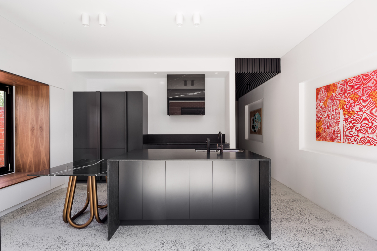 King George by Robeson Architects - Black Kitchen with Custom Marble Table