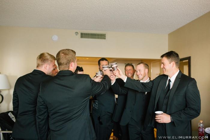 groom and groomsmen toasting