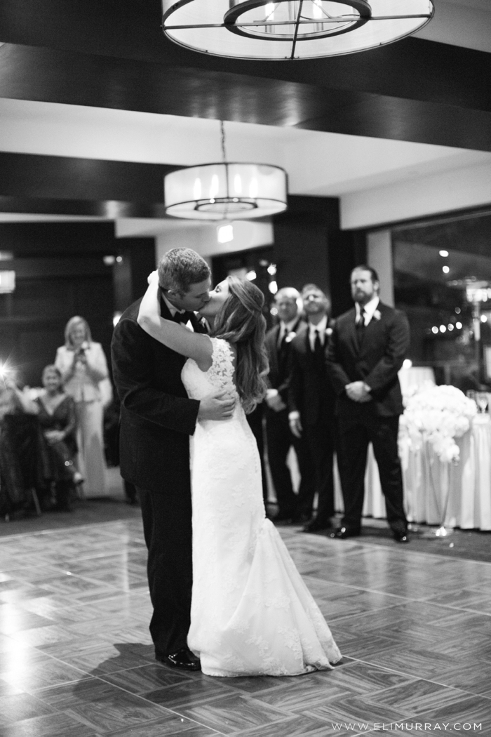 bride and groom kissing during first dance