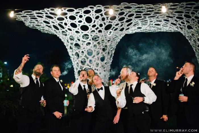 portrait of groomsmen smoking cigars