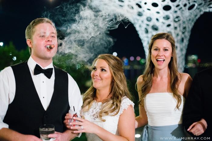 wedding party smoking cigars at reception