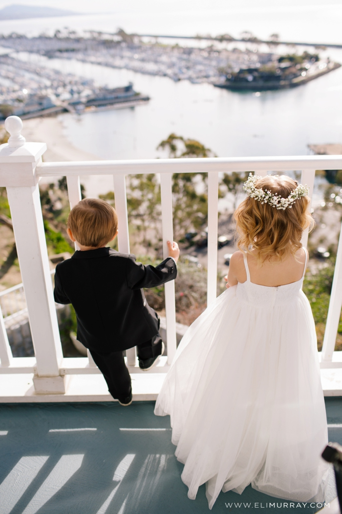 flower girl and ring bearer overlooking dana point harbor