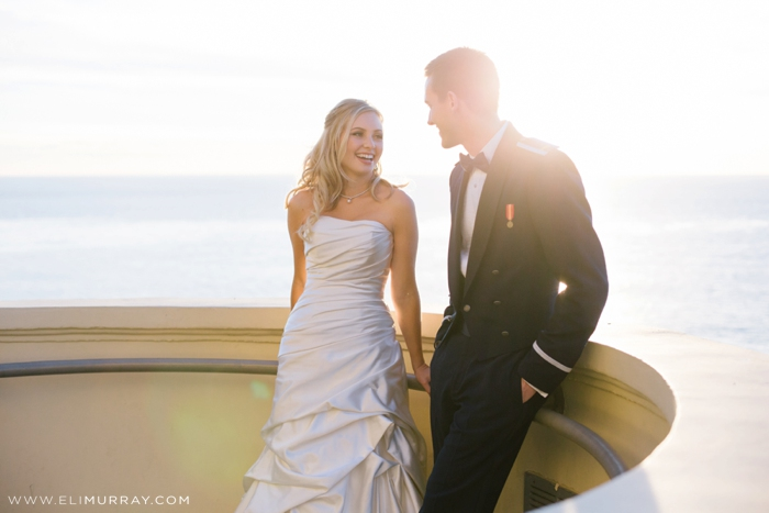 bride and groom on orange county coastline