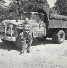 Victor Bothwell with Darien Asphalt Paving & Excavating's First Dump Truck. circa 1955