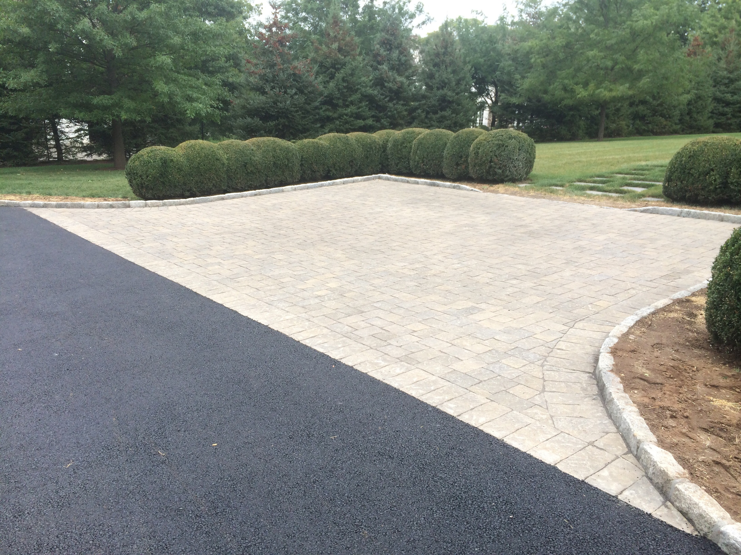 A driveway in Darien, CT with a parking area that has polymetric sand  to prevent erosion.