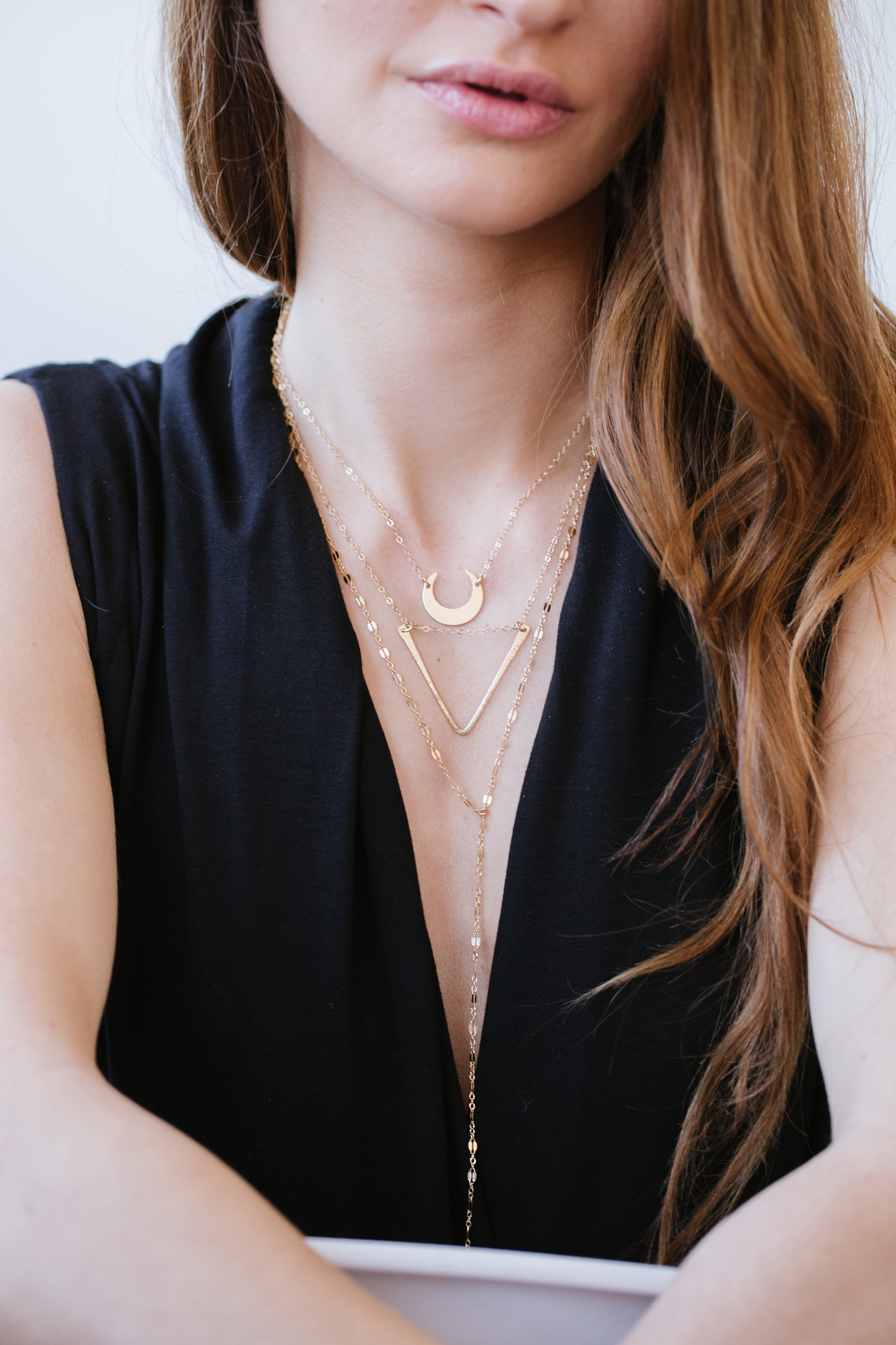 1.Necklaces: - 1. Choose a necklace that is already layered for you and only has one clasp or choose necklaces of various lengths that can be worn together.2. Don't worry about wearing all of the same metal color - mixing and matching is A-Ok in our book.3. Layer the pendants from the smallest on the top to the largest on the bottom. Lariats should go on the bottom too.